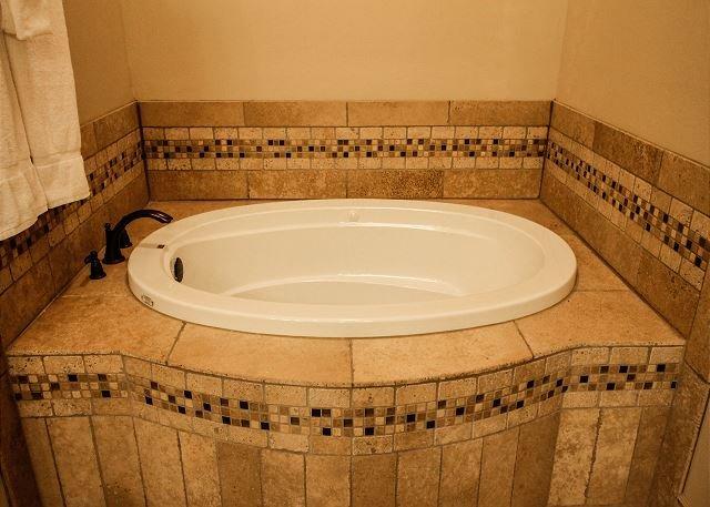 Raised, jetted tub
