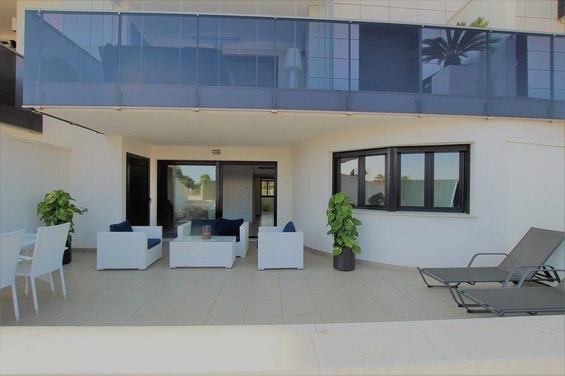 Private Terrace, with direct access to the communal pool
