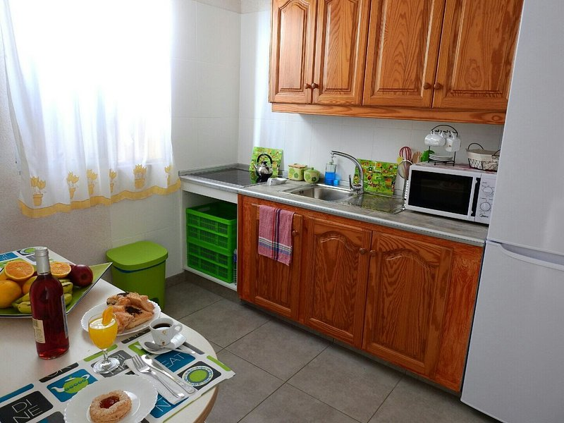 fully equipped kitchen with microwave, juicer, coffee maker, pots, pan etc ....