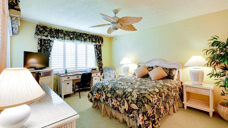 Master bedroom has computer desk, en suite bath with safety grab bars and walk-in closet