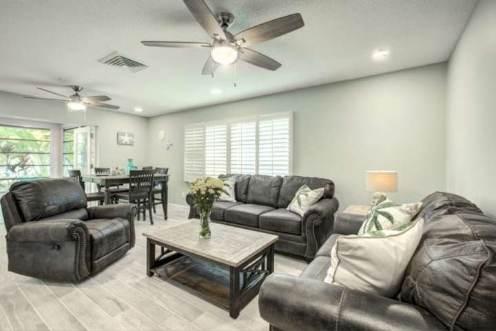 Open and bright living room with large Sharp flatscreen TV.