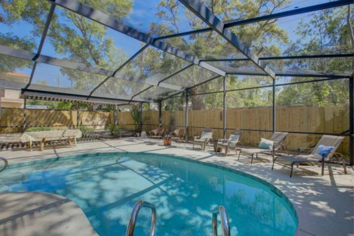 Large screened-in private pool with lots of lounging space for working on your tan.