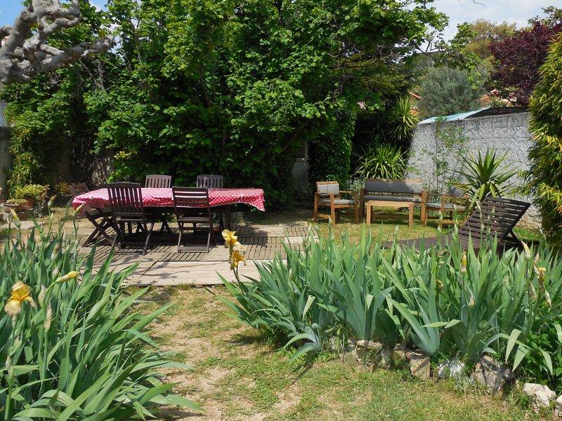 Garden with teak garden furniture