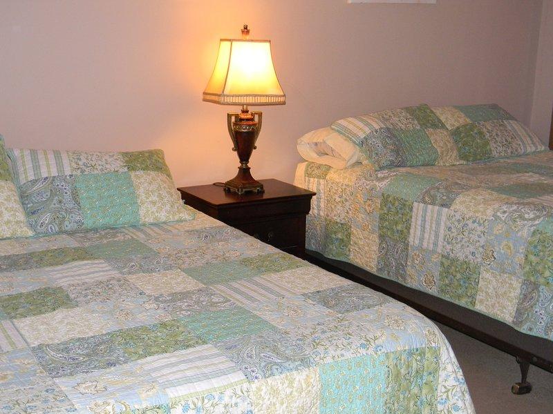 Bedroom in basement with two queen beds