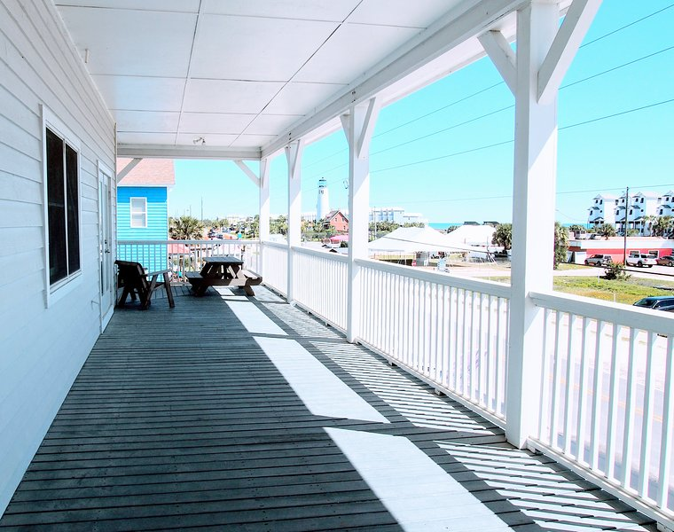 Deep wrap-around veranda with picnic table and sitting area to enjoy Gulf views.