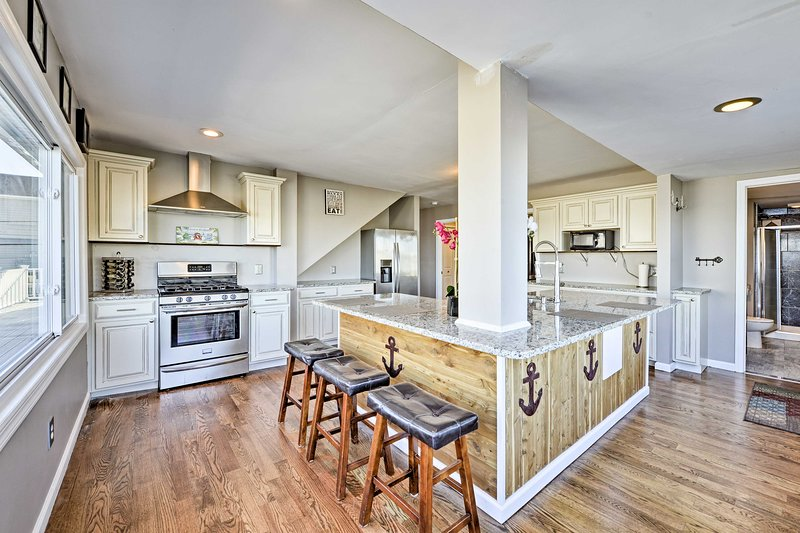 Try a new recipe in the fully equipped kitchen with stainless steel appliances.