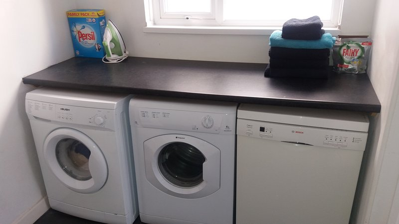 Utility room with washing machine dryer and dishwasher