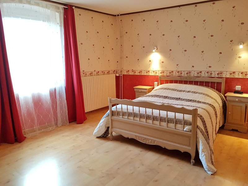 1 bedroom with double bed, television and bathroom