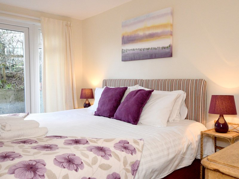 The pretty bedroom can be made up as twin beds or a super king