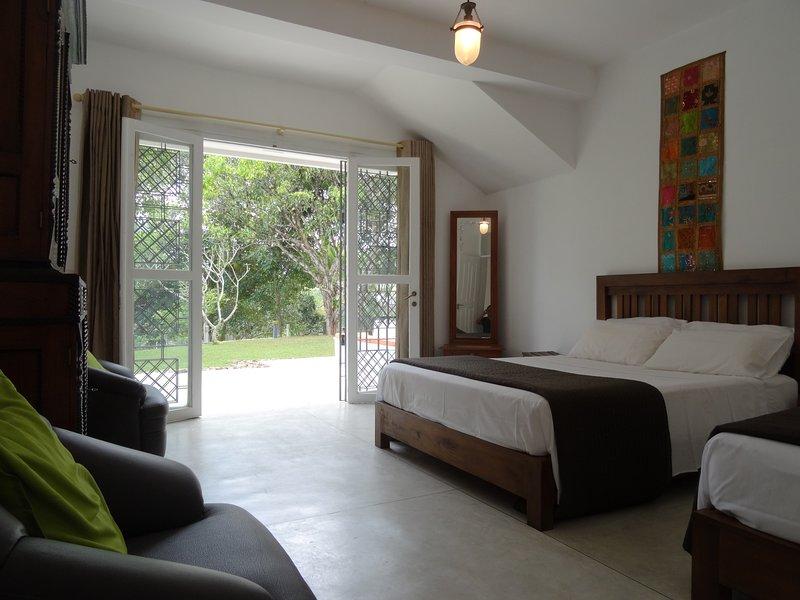 Triple kamer met toegang tot de tuin
