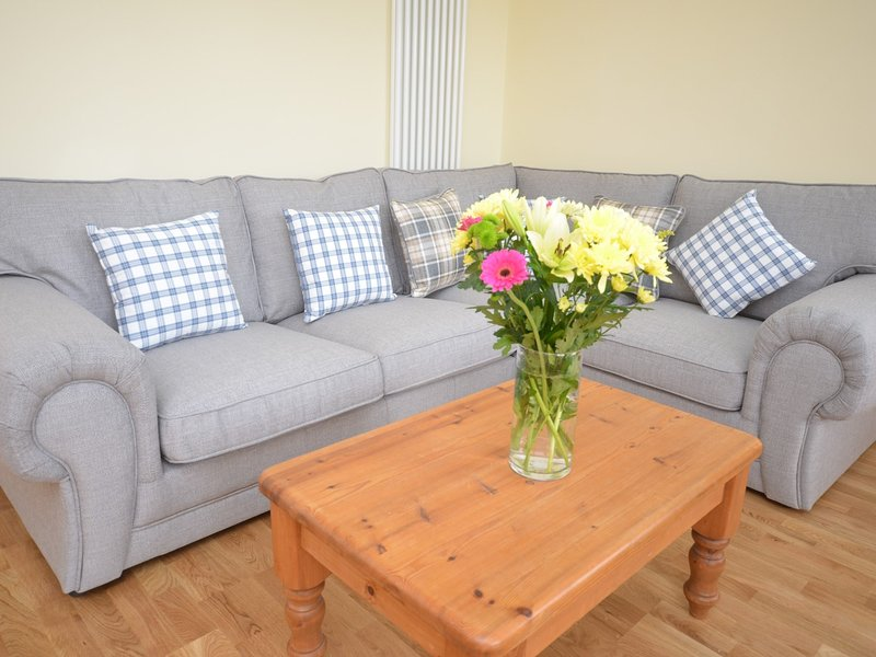 Cuddle up and watch a film on the comfy corner sofa