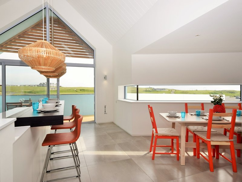Bright Kitchen/diner with doors to balcony with sea views