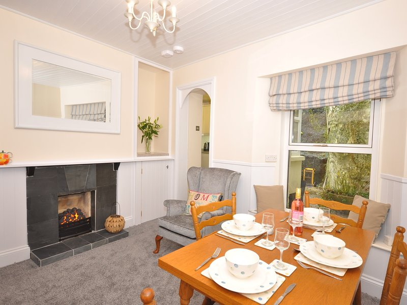 Dining area with gas fire leading to kitchen