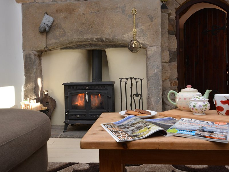Relax by the cosy woodburner