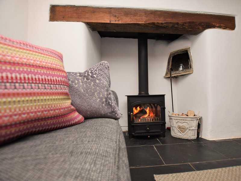 Cosy up in front of the fire after a day exploring the local area
