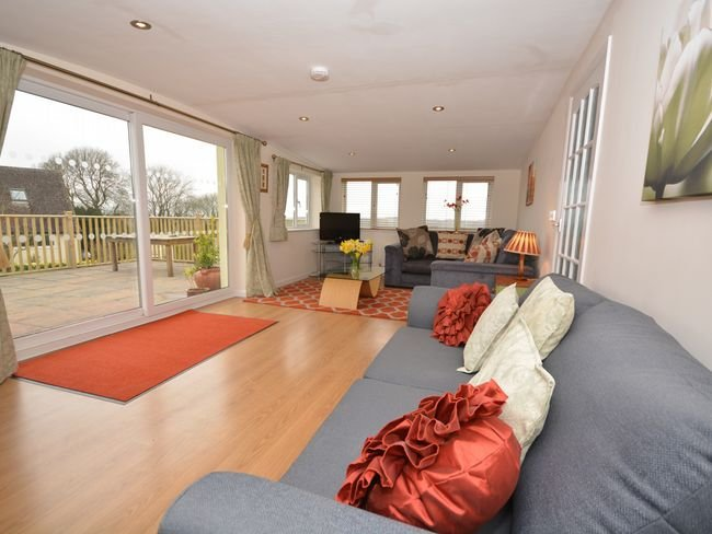 Lounge leading to enclosed decked area