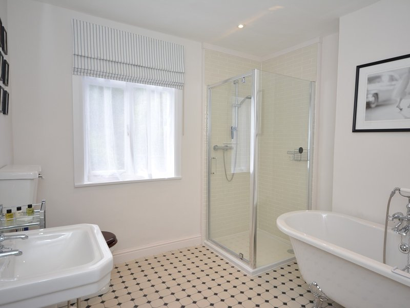 Bathroom with roll-top bath, shower and WC