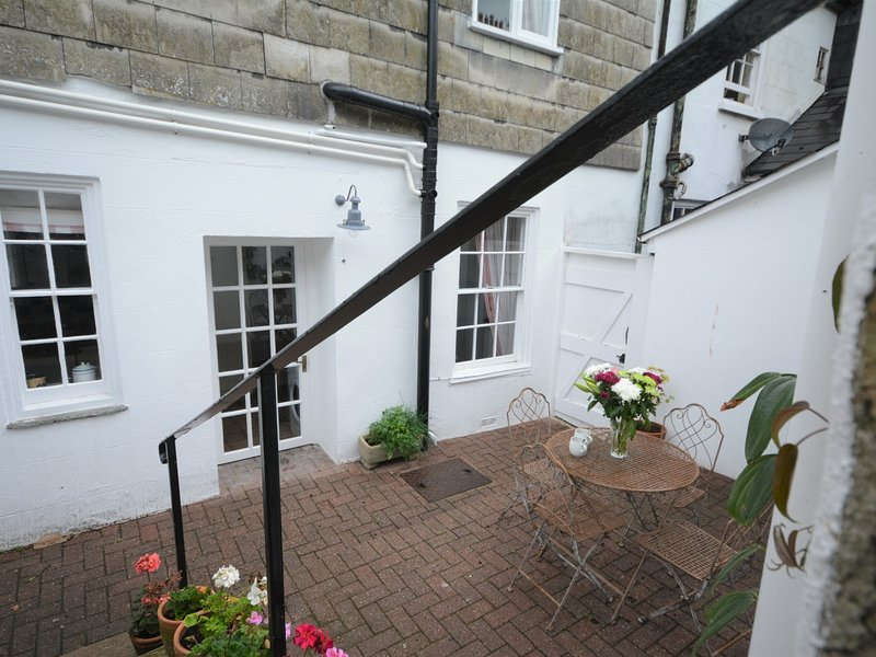 The enclosed courtyard with seating at the rear of the property