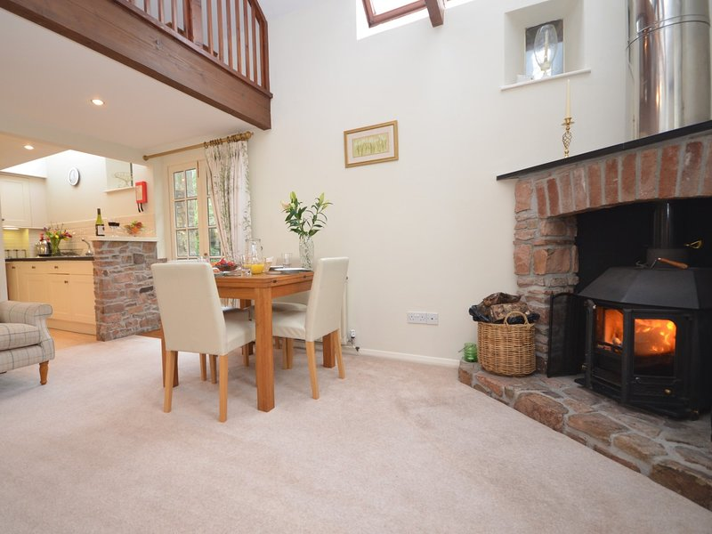 Warming woodburner set in the feature fireplace