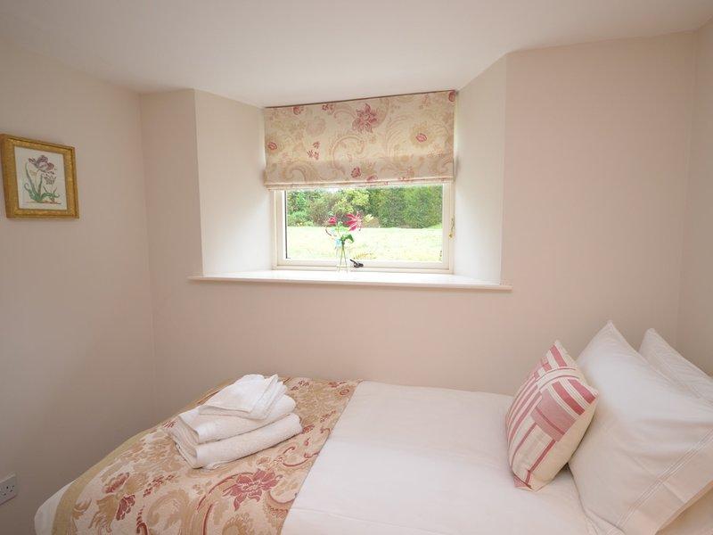 Single bedroom overlooking the garden