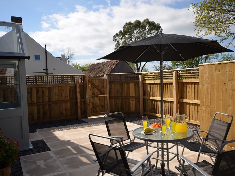 Enclosed suntrapped patio,a perfect place to enjoy some outside dining