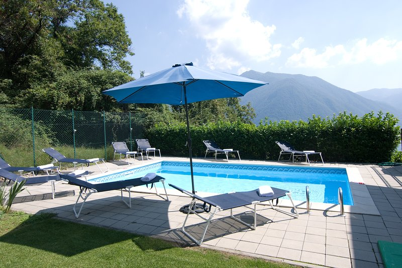 Stunning pool with plenty of sunbathing & lawned area