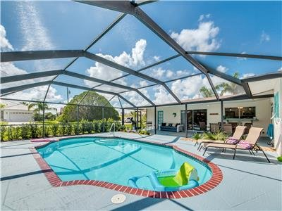Covered lanai with screened-in Pool and sun deck. Electric and solar heater available.