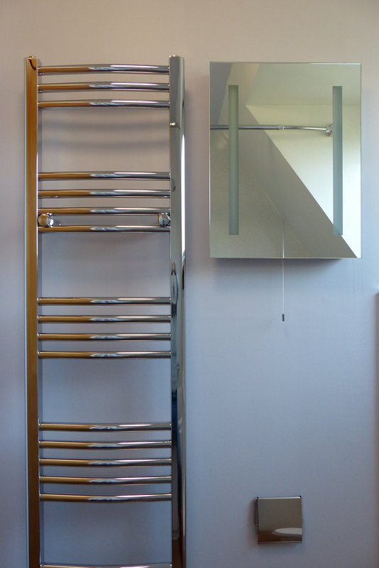 Heated towel rail and mirror with lights and shaver socket