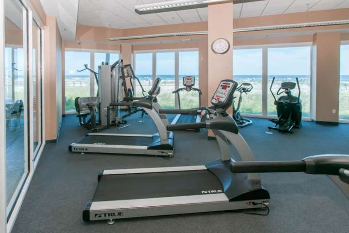Community fitness center overlooking beach and Gulf