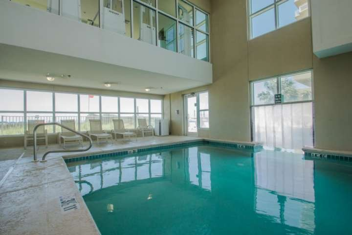 Heated indoor pool with lounge chairs