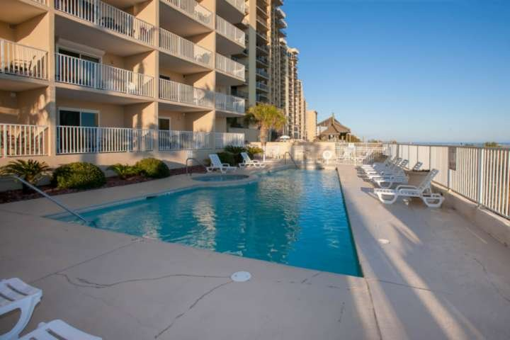 Community pool and hot tub overlooking the beach and the Gulf