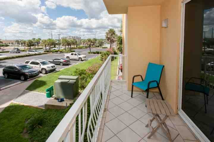 Wrap around balcony with lounging area and neighborhood view