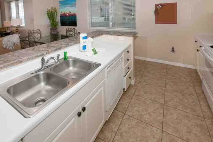 Open kitchen with ceramic tile floor and full appliances