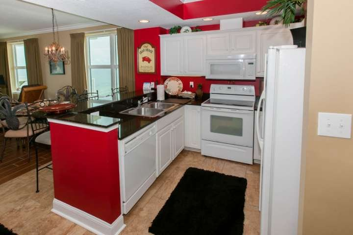 Open, fully-equipped kitchen with recessed lighting