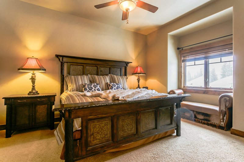 Master bedroom with King bed on upper level.