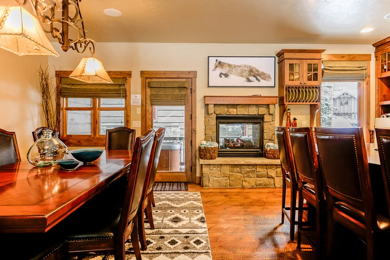 Lots of space to mingle, fireplace, and deck access to hot tub.