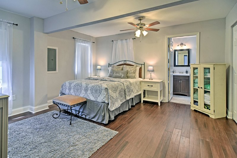 Charming decor and beautiful hardwood floors make this bedroom warm and inviting.