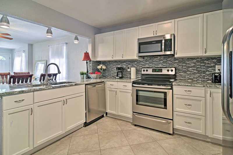 New granite countertops provide ample space to fix your favorite meal.