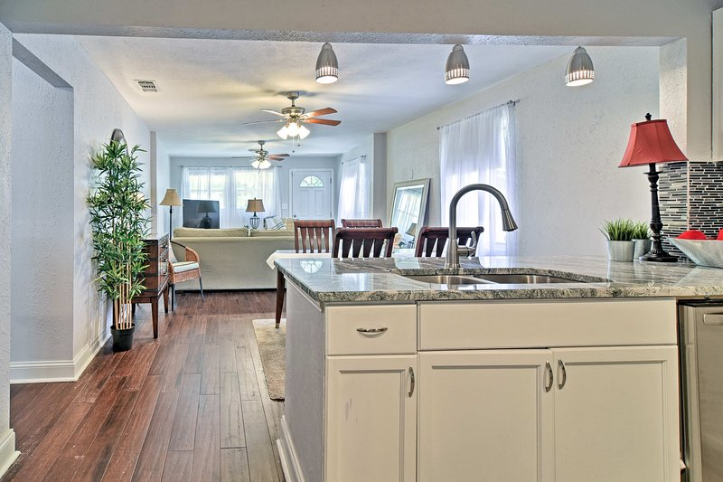 The open floor plan home is bright with natural light pouring in through windows.