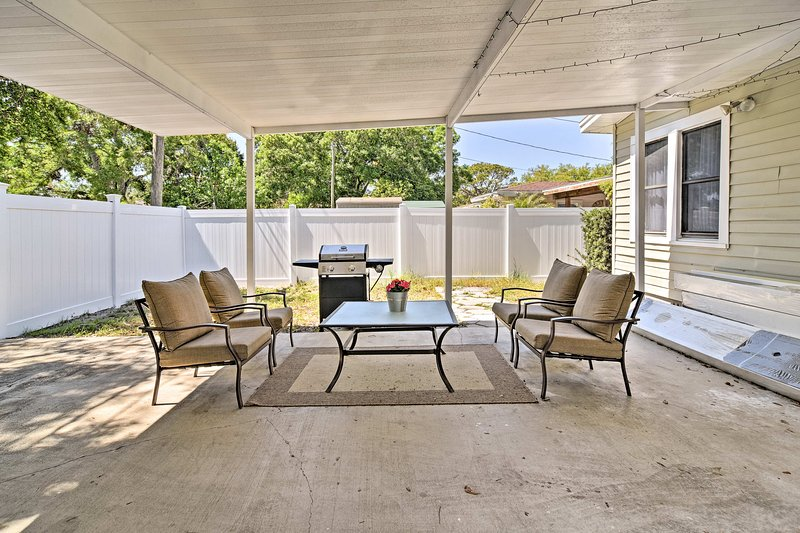 Enjoy a summer evening with friends and family on the covered back patio.