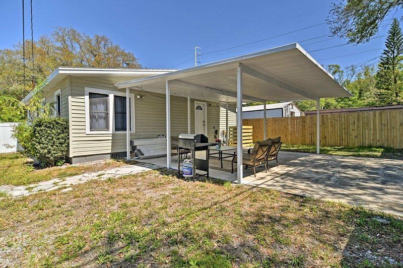 A spacious backyard surrounds this adorable Tampa Bay bungalow.