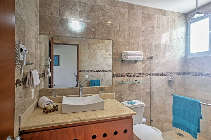 The full bathroom is filled with tile.
