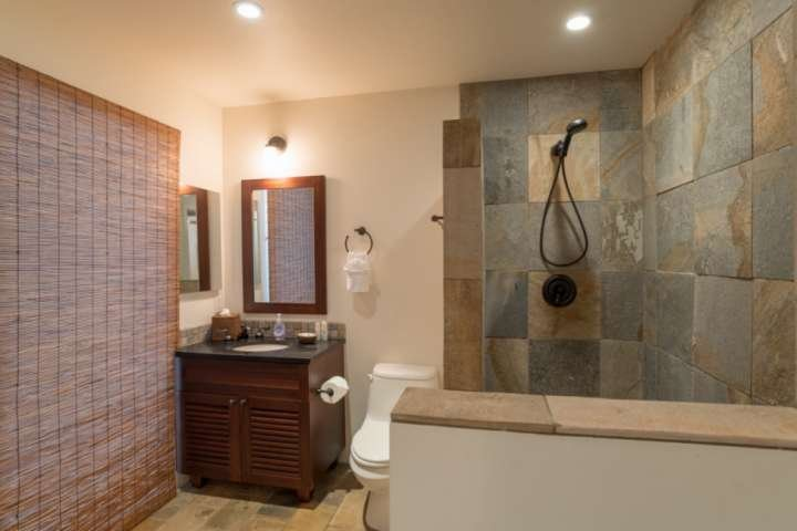 Both bathrooms feature large walk in showers