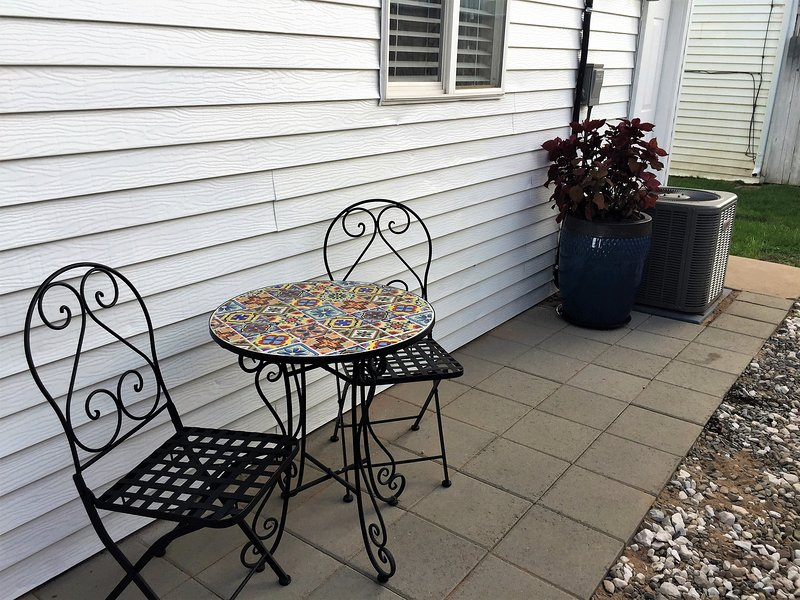 Enjoy a cup of coffee or a cool drink on the cozy back patio.