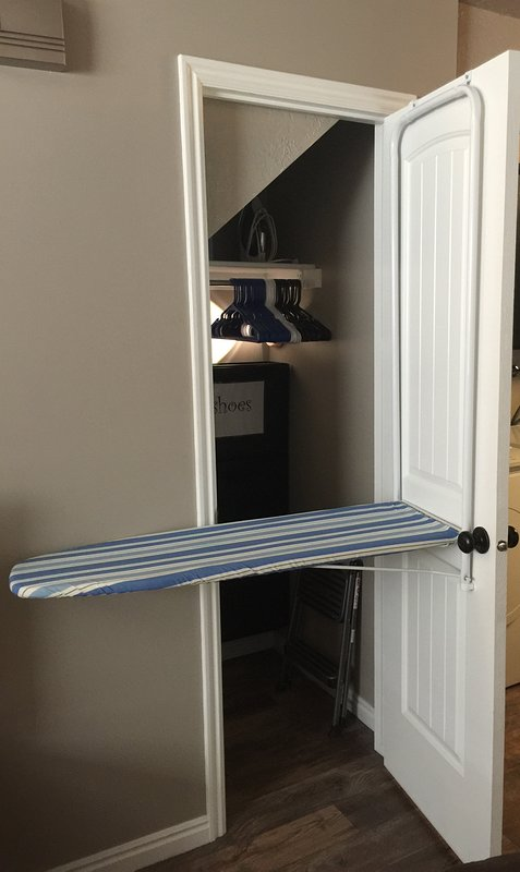 Space saving ironing board that conveniently folds down from the large storage closet.