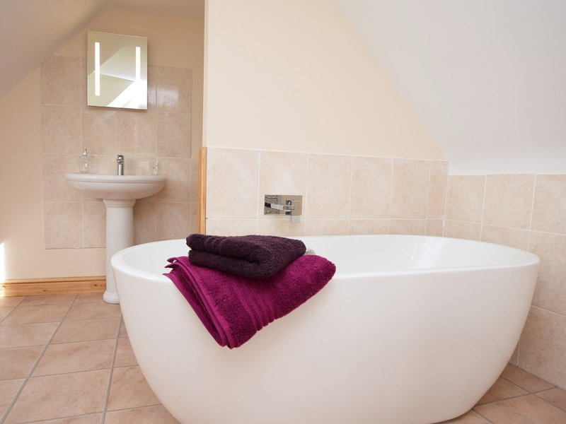 En-suite bathroom with freestanding bath