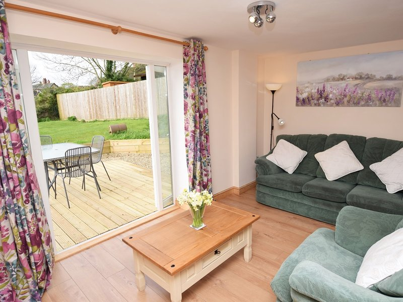 Lounge with French doors leading to the garden