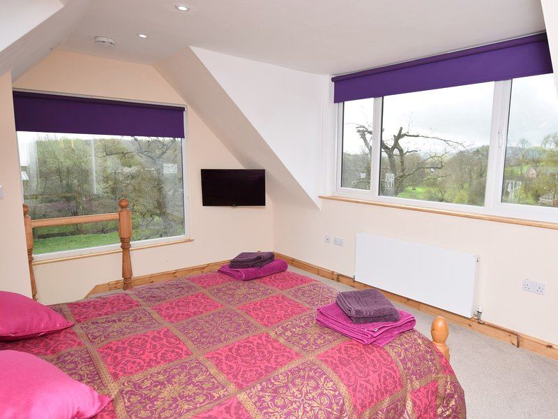 King-size bedroom with views over the countryside