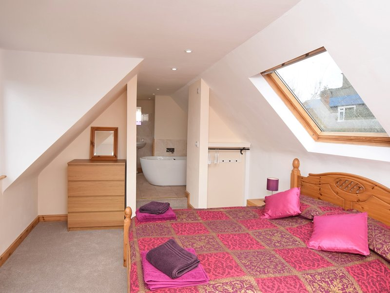 King-size bedroom and en-suite bathroom