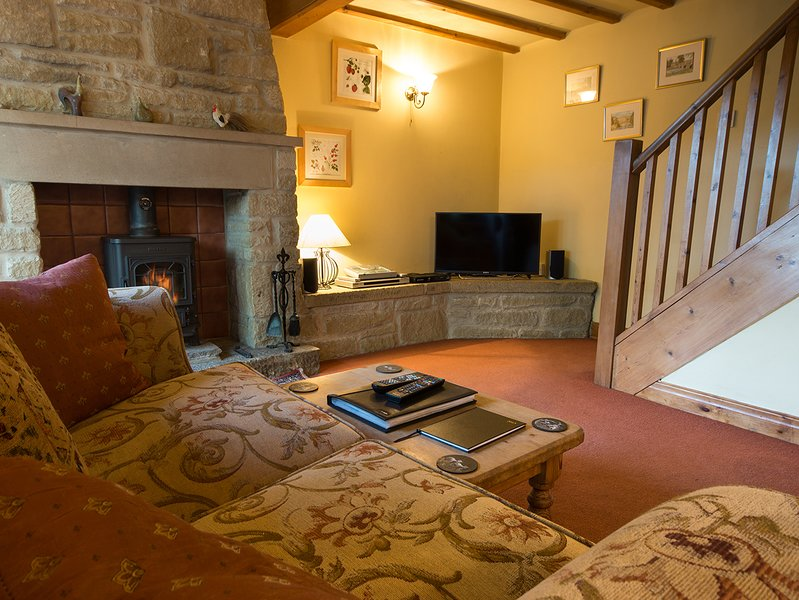 Charming room with cosy wood burning stove and beams